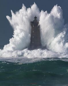 Wave bigger than the lighthouse it's hitting