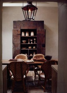 rustic wood dining room, old wood furniture, rattan chairs