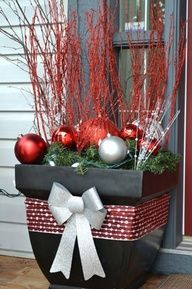 31 Cool Outside Christmas Decorations now this is cute!!! use a pot plant...put some ribbon and a bow around it an stick green garland in it and Christmas ball ornaments and those tall stick thingys!! got itttt! (;