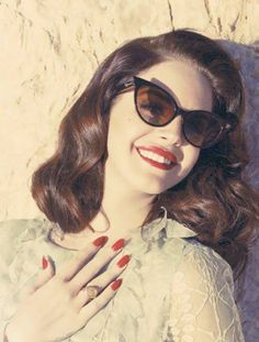 That's what they wore back in the 50's, cat eyes sunglasses and cherry red fingernail polish.