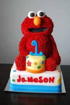 3D Elmo - My first 3D Cake. Elmo's torso is cake. His head, arms and legs are rice krispy treats