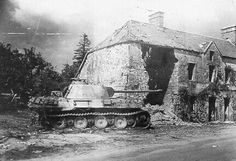 A damaged Panther Ausf A sits after the fighting in Carentan.