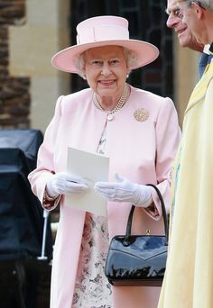 Pin for Later: The Queen's Got a Coat Set in Every Single Color A Wide-Brimmed Hat to Match a Light-Pink Coat