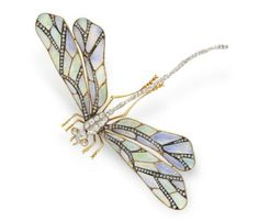 An Art Nouveau opal and diamond dragonfly brooch.