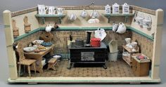 """A 1920s painted wood doll house kitchen by Maurice Gottschalk, 23ins wide x 11ins deep x 11ins high, and a selection of original china and other fitments, and with electric light Note: See Ziliner & Cooper, """"Doll Houses and their Furnishings"""", p.95"""
