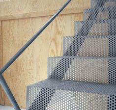 Ah-HA!  This is what we can do outside the back door that currently has a cement landing and staircase built directly over a basement window (the stupidest design decision EVER!).  Perforated metal would be the perfect replacement to let light into the rec room.