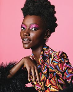 black model with pink glitter eyeshadow and colorful print jacket