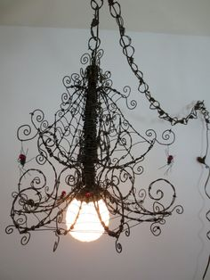 Barbed Wire Chandelier Infested With Spiders and Festooned With Webs