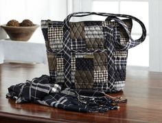 "Carrington Collection by Bella Taylor. The Carrington Collection features rich warm colors in black, brown and tan. The Stride Handbag measures 11x4x11"" with 2 27.5"" straps that give a shoulder drop of  12.75"" and 6 outside slip pockets, 1 inside zip pocket, 3 inside slip  pockets and a top zip closure and a hidden, removable plastic insert for  structure."
