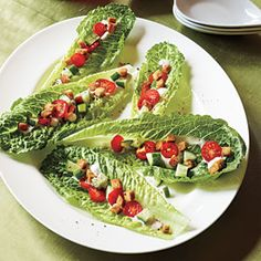 Caesar Salad Bites. Romaine hearts are so crisp and tasty. This looks appetizing on a platter. And they are extremely easy to eat with your fingers:)