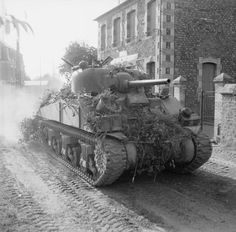 A Sherman tank passing through Le Beny Bocage, 1 August 1944.