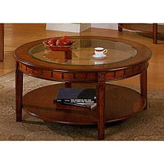 @Overstock - Add an elegant accent to the living room with this round coffee table featuring a rich, warm cherry finish. The beveled glass top offers a safe place to set drinks and showcase knickknacks, while the wooden lower shelf holds books and magazines. http://www.overstock.com/Home-Garden/Cherry-Finish-Round-Coffee-Table/4333373/product.html?CID=214117 $314.99