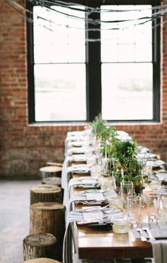 long rustic table with stump seating