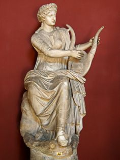 The Muse Terpsichore, Roman statue (marble), copy after Hellenistic original, head and body do not belong, 2nd century AD (body), (Musei Vaticani, Vatican City).