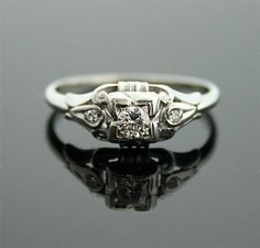 1930s Engagement Ring - White Gold and Diamond Antique Ring.   via Etsy.