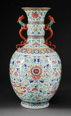 Qianlong mark Doucai Porcelain Vase, probably c., bulbous body with molded flared neck and sinuous dragon handles, decorated with Buddhist symbols amid scrolling foliage and flowers; base with Qianlong mark; Antique Bottles, Antique Glass, Vintage Bottles, Vintage Perfume, Japanese Porcelain, Japanese Pottery, Porcelain Ceramics, Ceramic Vase, Pottery Vase