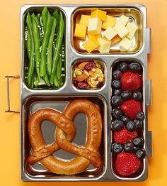 We don't know a single kid that wouldn't smile opening up a lunch box with a Rudi's Organic Bakery multigrain soft pretzel, green beans with sesame seeds, cheese, trail mix, and berries.