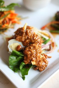 Indonesian Gado-gado (vegetable with peanut sauce dressing) is so delicious! I eat mine with mango and pineapple; delicious!
