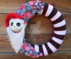 Jack Skellington as Sandy Claws wreath by HalloQween Creations that can be found on facebook, Etsy, and Deviantart