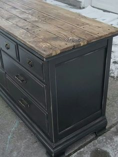 Painted Bassett Dresser - a more formal piece of furniture is given a rustic redo with a distressed black paint finish and a salvaged wood plank top - via Tattered Lantern #Refinishedfurniture #rusticwoodfurniture