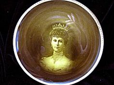 """Circa: 1911  Size: 9"""" - 22.8cm.  Manufacturer: Ridgways.    Ridgways plate with a portrait of Queen Mary (Consort of King George V) 35.00"""