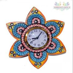 You may want to check out this paper mache wall clock if you like wall clocks with unconventional themes and designs. This will steal your attention with its floral design and multiple colors. This clock is wooden base it is made of chalk, soil and paper.