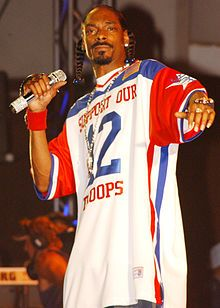 Calvin Cordozar Broadus, Jr. (born October 20, 1971), better known by his stage name Snoop Dogg (formerly known as Snoop Doggy Dogg), is an American rapper, singer, record producer, and actor. Snoop is best known as a rapper in the West Coast hip hop scene, and for being one of Dr. Dre's most notable protégés