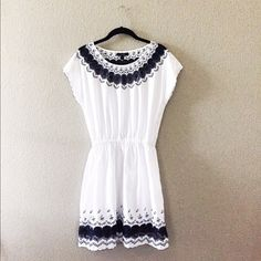 J. Crew White and Blue Embroidered Scallop Dress☀️ Gorgeous white and navy blue summer dress. Perfect for the upcoming warm months! Beautiful embroidered neckline and bottom hemline. Perfect condition except for faint initials written above interior tag. Obviously not noticeable when worn! More pictures to come. J. Crew Dresses Mini