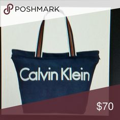 """Calvin Klein packable canvas tote New with tag.Navy blue. 10""""double handle drop. Silver hardware. 13""""L x 12.5""""H x 7""""D. Back outside slip pocket. Top zip closure. 1 zip pocket inside. Authentic. Calvin Klein Bags Totes"""