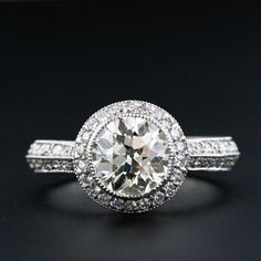 1.58 carat European cut. Bezel set, not as pretty when viewed from the side. 20 Round Brilliant cut accent diamonds.
