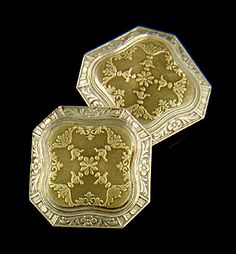 Elegant gold cufflinks from the golden Age of Jazz.  Yellow gold centers with intricate swag and foliate motifs are surrounded by white gold borders decorated with floral and abstract designs.  Crafted in 14kt gold,  circa 1920.