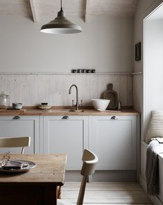 Allendale Dove Grey Kitchen by Howdens. Chrome effect handles Solid oak block worktop and upstand, Lamona ceramic undermount sink, Lamona Adra tap. Grey Kitchen. Nordic Kitchen. Urban Wild kitchen trend.