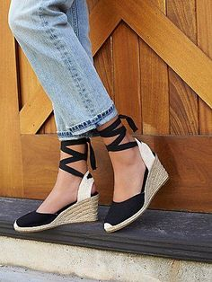 Naples Espadrille Wedge   Classic espadrilles with jute wedges and ribbons that lace up the leg.