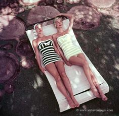 Classic 1954 color fashion photo by Milton H. Greene of two models with vintage striped bathing suits.