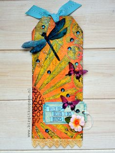 by Birgit Koopsen Base tag is a printed Prima tag with layers added