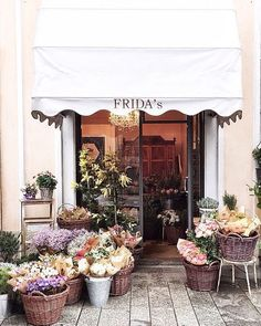 flowers on display + entrance to frida's, a flower shop in milan