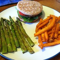 Dinner: veggie burger topped with tomato and spinach on a whole wheat sandwich thin. Sweet potato fries and roasted asparagus on the side