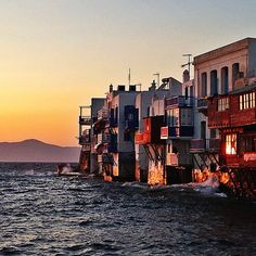 """""""Little Venice"""" is absolutely magical under the red sunset. Thank you for sharing    Greece Mykonos Island, Red Sunset, Venice, New York Skyline, Greece, Travel, Greece Country, Viajes, Venice Italy"""