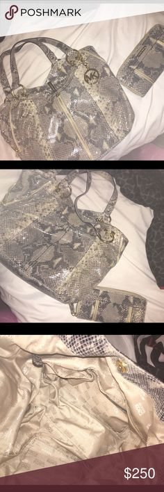Snake skin Michael Kors purse and matching wallet! This purse and matching wallet are in excellent condition. Like new! FEEL FREE TO SHOOT AN OFFER! :) Michael Kors Bags Shoulder Bags
