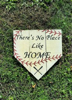 Theres No Place Like Home Baseball Pallet Sign Details  Theres No Place Like Home Baseball Pallet Sign *Actual home plate size approximately 17x15 in, acrylic paint, wood glue,screws *Please note wood imperfections may differ from sign to sign due to the recycled hand made nature of this product Material: Recycled wood, Acrylic paint, Wood Glue, Screws