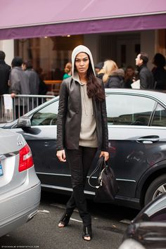 Joan Smalls ...love the light grey hoodie, leather jacket and eyeliner