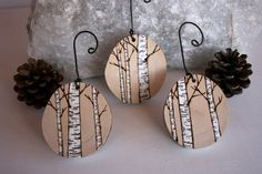 A set of handmade, woodburned (with snowy white paint accents) birch tree ...holesinyoursocks.com