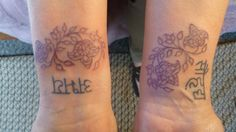 Susan's new wrist tattoos. I did the purple vines. The Sanskrit characters were already there.