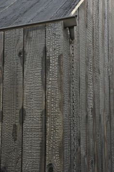 shou sugi ban siding with Gutter detail and chain down spout: