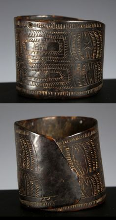 Papua New Guinea ~ Papua Gulf   Turtle shell arm ornament; carved from thick piece of carapace;decorated with incised abstract linear motif. On the upper rim are two carved holes, presumably for seed or shell attachments   Early 20th century   1'100 AUD