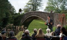 Telling the tale of Tam O' Shanter beside the Brig O' Doon at the Burns Storytelling Festival, Alloway