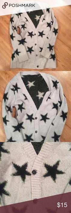 Soft black and grey star cardigan It is a grey cardigan covered in black stars. Very comfortable and perfect for the fall! signature8 Sweaters Cardigans