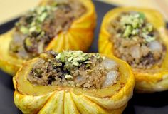 Squash is abundant this season, from giant varieties to petite ones like these sweet dumpling squash. We recently picked up a few of these from Weiser Family Farms and intended to bake them with just a little butter and maple syrup. Then, a pot of leftover quinoa and some farmers' market pistachios and dates inspired us to make these little side dishes. The sweet and savory quinoa stuffing could be used for acorn or other winter squash, too.