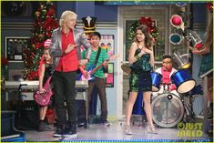 The A & A Music Factory Celebrates Their First Christmas - See The Pics!: Photo #902082. Ally (Laura Marano) and Austin (Ross Lynch) perform a new holiday song for their Music Factory students in this new still from Austin & Ally.    In