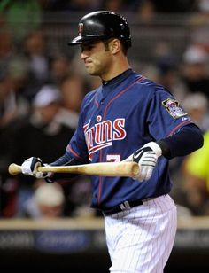 Joe Mauer #7 of the Minnesota Twins reacts to striking out against the Texas Rangers during the fifth inning on April 13, 2012